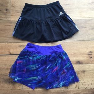 Two girls adidas 6 and 6 X skirts